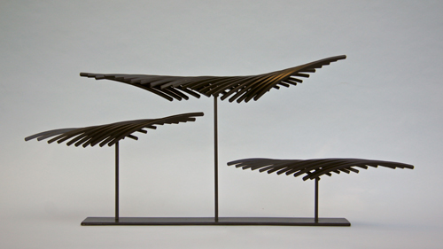 "Kinetic sculpture by Amos Robinson ""Feathers on the Wind"" contemporary art stainless steel San Diego artist"
