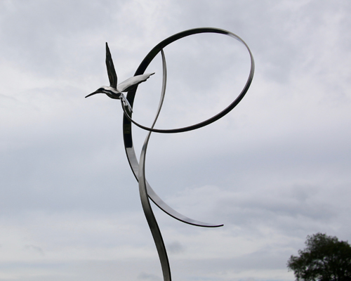 "Kinetic sculpture by Amos Robinson ""Hummingbird in Flight"" contemporary art stainless steel San Diego artist"