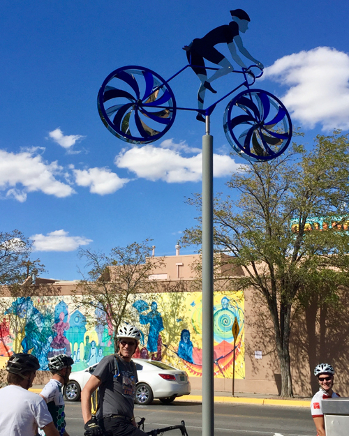 Kinetic bicycle sculpture by Amos Robinson contemporary art stainless steel Gallup New Mexico
