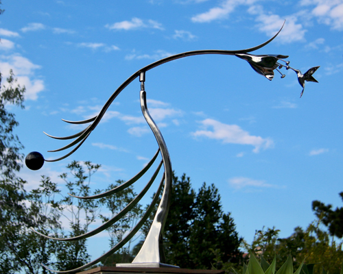 Hummingbird kinetic art by Amos Robinson Kiss stainless steel contemporary art