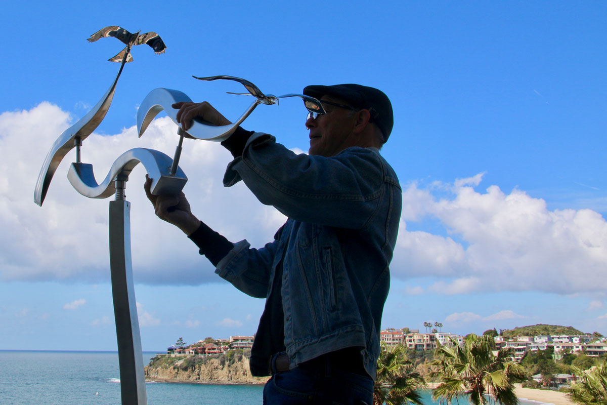 Kinetic art by Amos Robinson stainless steel contemporary art Laguna Beach California installation