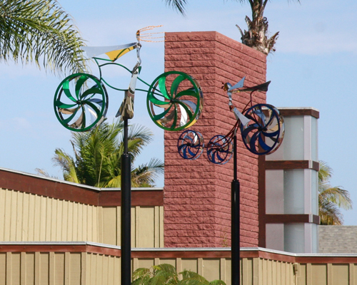 Kinetic bicycle and tricycle sculptures by Amos Robinson contemporary art stainless steel
