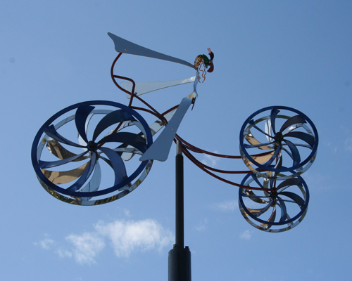 Kinetic tricycle sculpture by Amos Robinson contemporary art stainless steel
