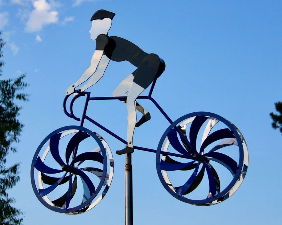 Kinetic bicycle sculpture by Amos Robinson contemporary stainless steel art