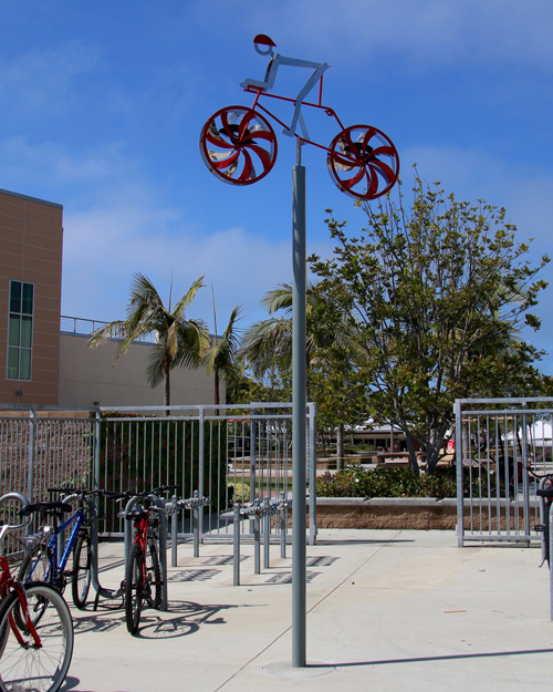 "Kinetic bicycle sculpture by Amos Robinson ""Redondo Seahawks"" contemporary art stainless steel"