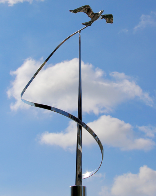 Kinetic art by Amos Robinson stainless steel bird in flight contemporary art