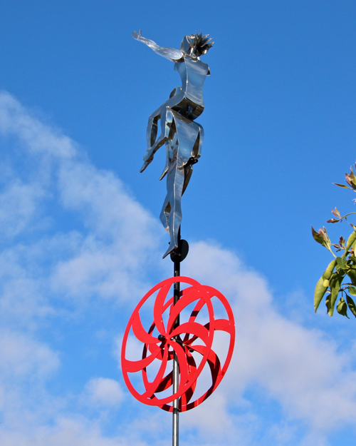 Kinetic art by Amos Robinson Lift Me With Your Love unicycle stainless steel contemporary art
