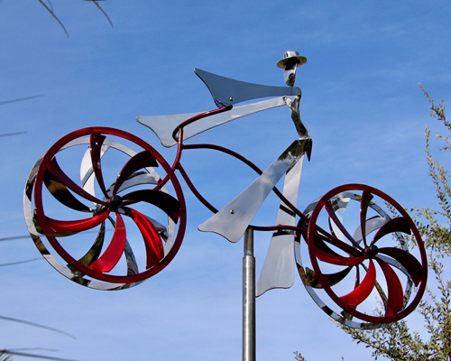 Kinetic art by Amos Robinson Roy Rides Again bicycle sculpture stainless steel