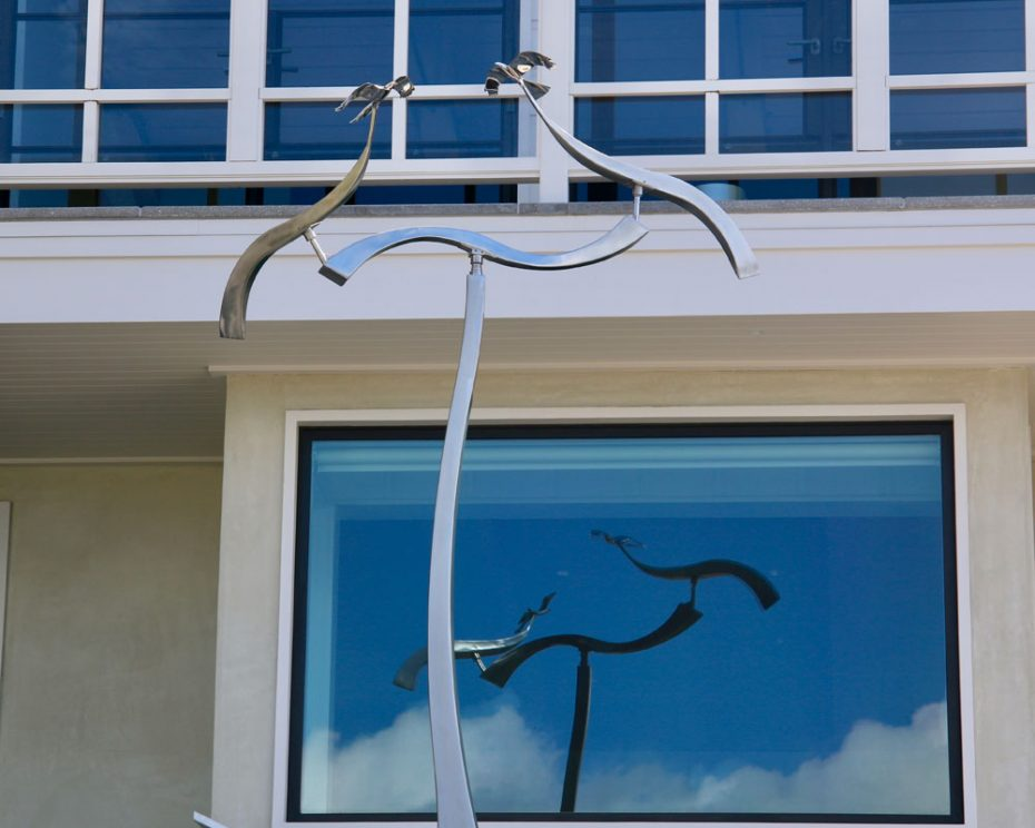 Kinetic art by Amos Robinson Crossing Paths contemporary art stainless steel