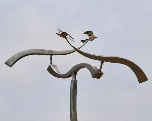 Kinetic art by Amos Robinson Crossing Paths birds in flight stainless steel contemporary art