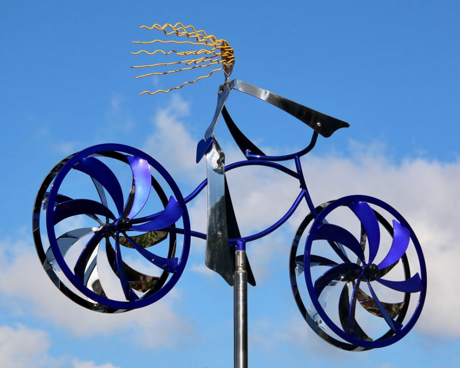 Kinetic art by Amos Robinson Bluebonnet Rider stainless steel contemporary art bicycle and female rider