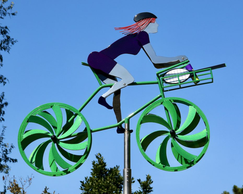 Kinetic bicycle sculpture by Amos Robinson Linda Living the Dream stainless steel contemporary art